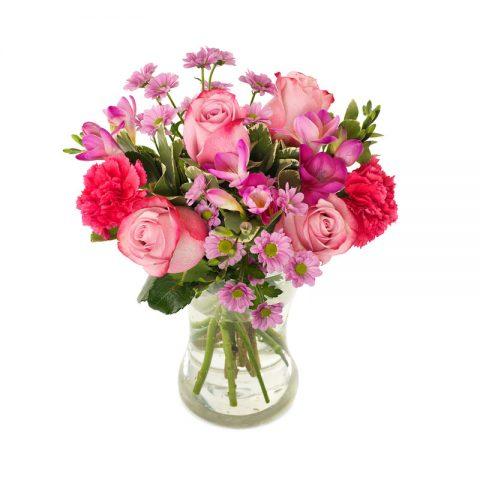 Boeket roze bloemen standaard