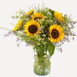 Zonnebloemen met vaas